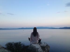 Sitting on sunset rock, Silver Island.